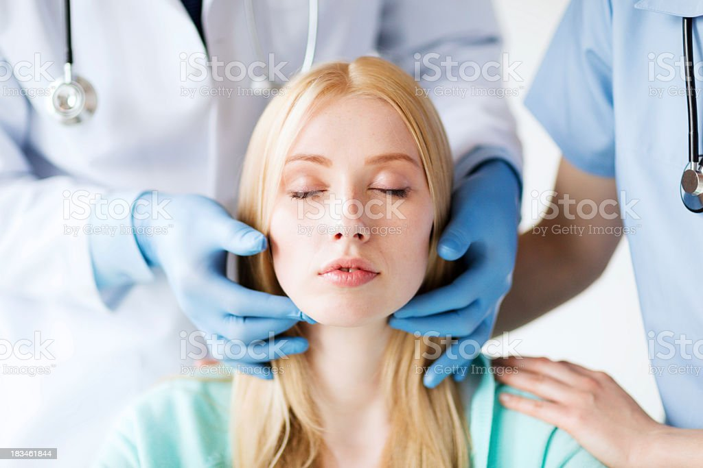 surgeon or doctor with patient stock photo