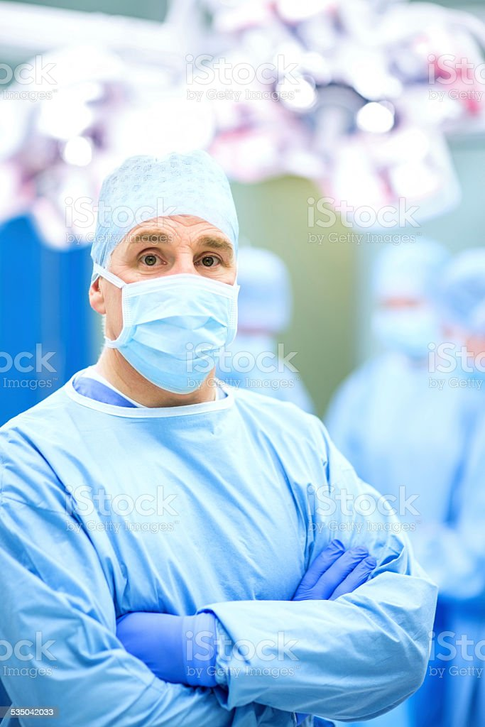 Surgeon Standing Arms Crossed In Operating Room stock photo