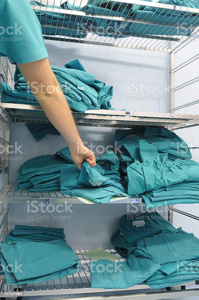 Surgeon taking  clean scrubs stock photo