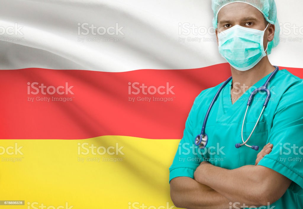 Surgeon with flag on background series - South Ossetia stock photo