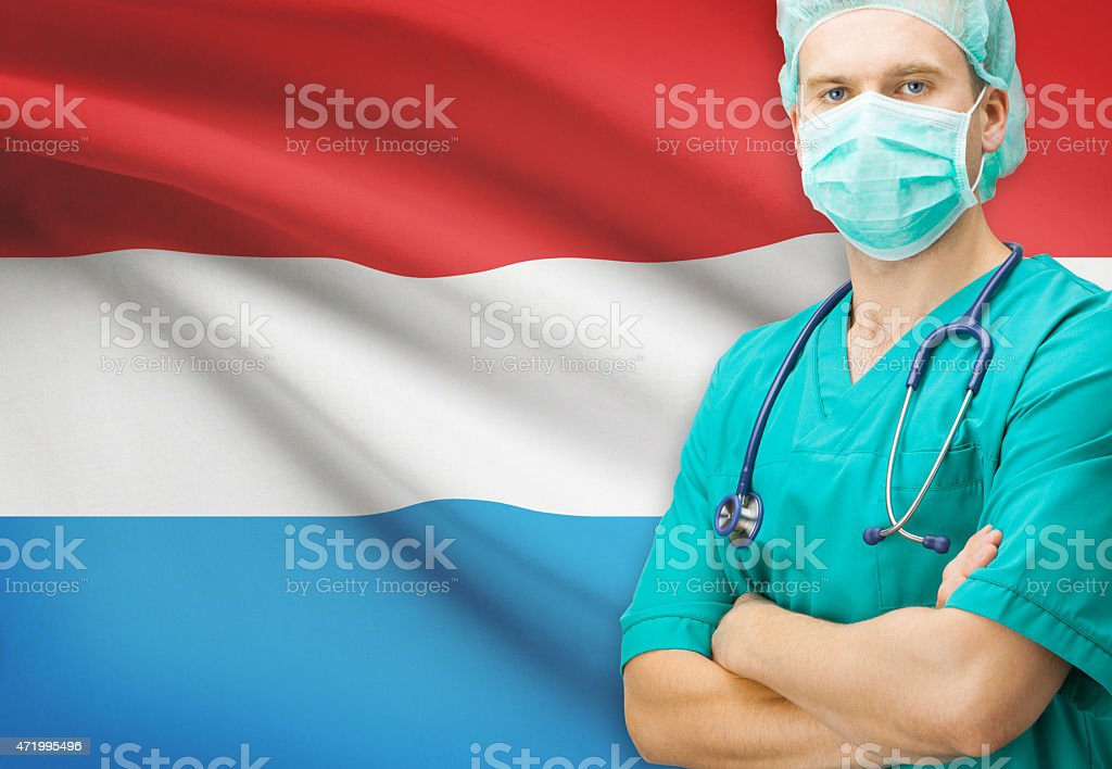 Surgeon with national flag on background series - Luxembourg stock photo