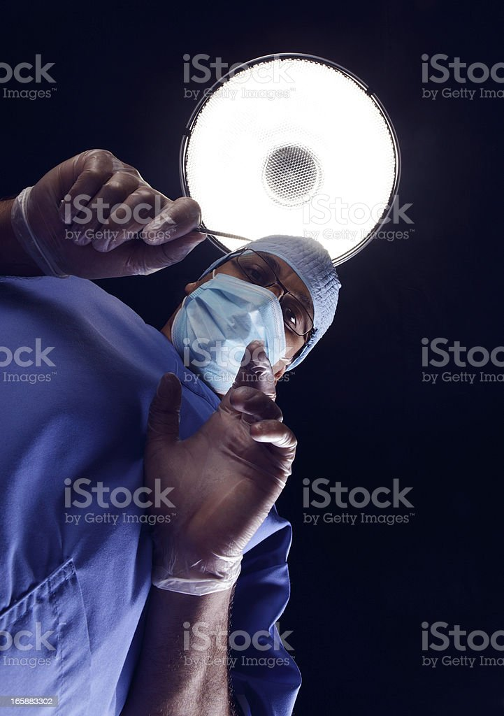 Surgeon with scalpel stock photo