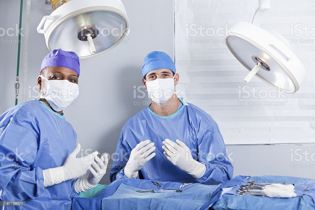 Surgeons in operating room stock photo