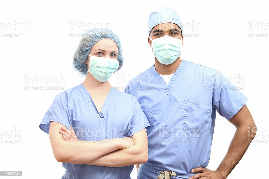 Surgeons in scrubs and face masks royalty-free stock photo