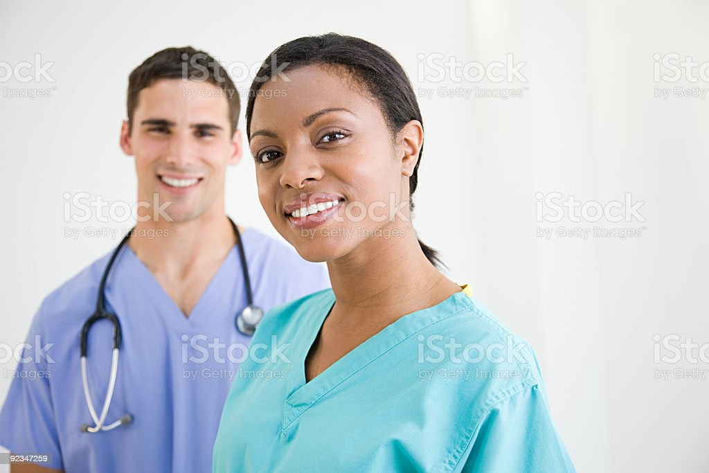 Surgeons in scrubs stock photo