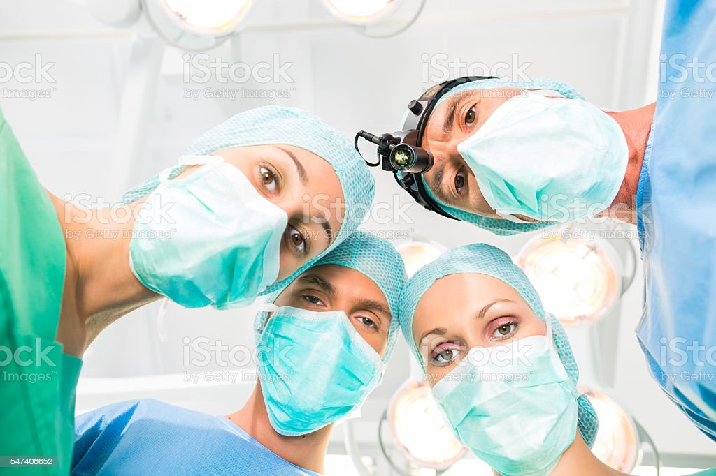 Surgeons operating patient in operation theater stock photo