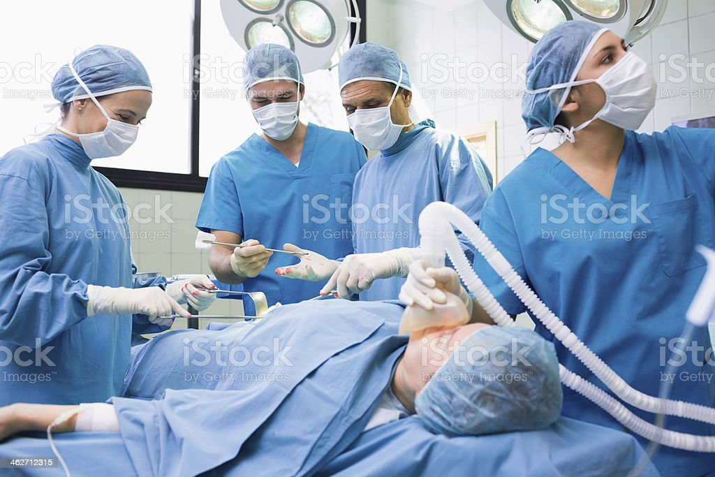 Surgeons operating the stomach of a patient stock photo