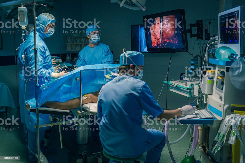 Surgeons performing surgery stock photo