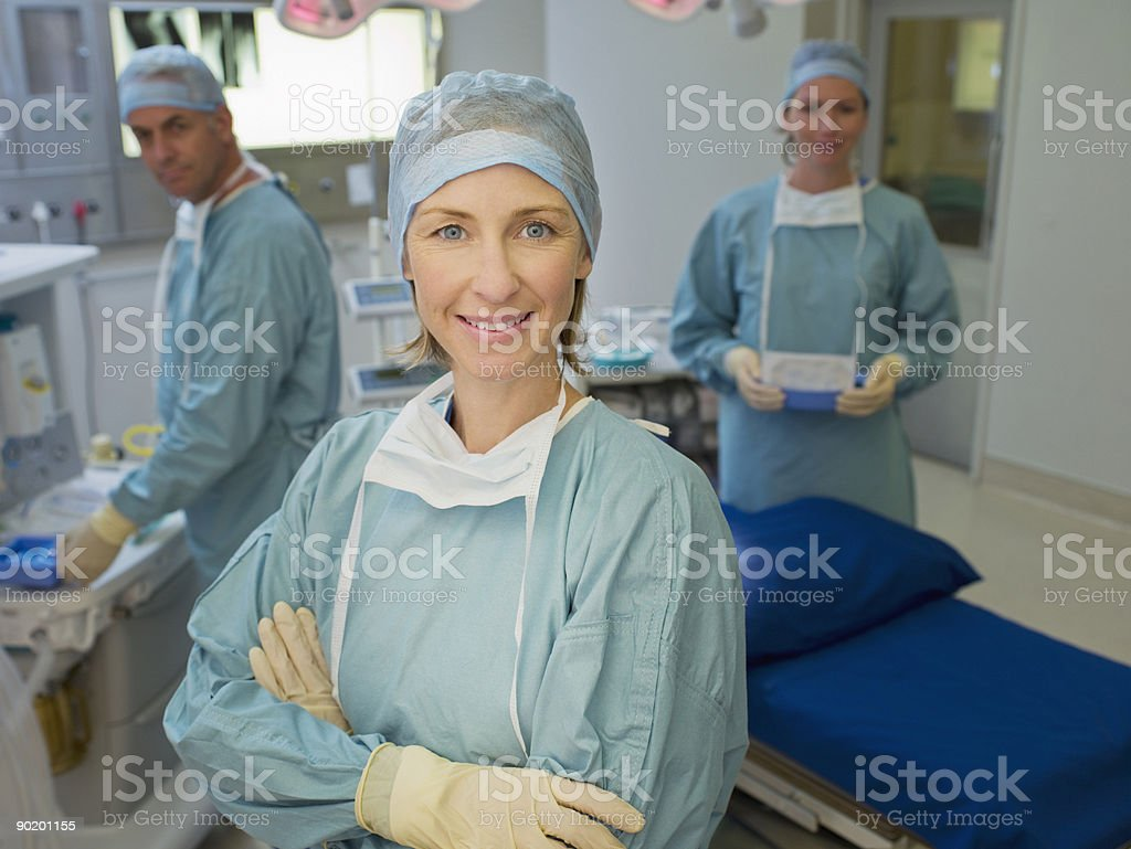 Surgeons preparing for surgery in operating room royalty-free stock photo