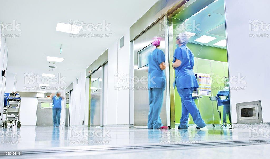 Surgeons talk in a hospital corridor stock photo
