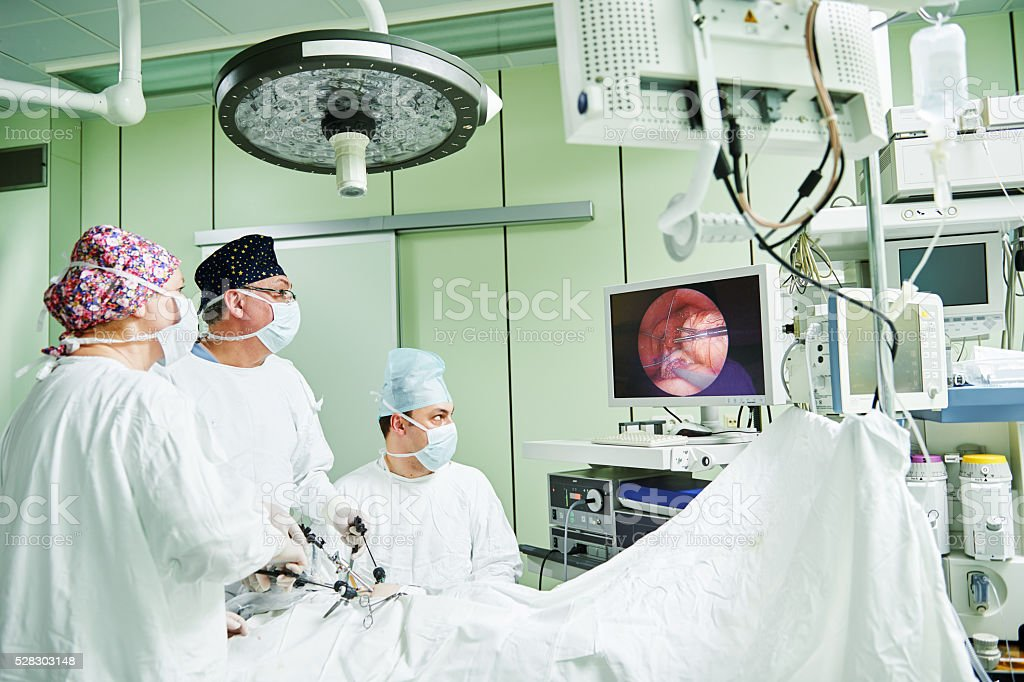 surgeons team hands during laparoscopic abdominal operation in child surgery stock photo