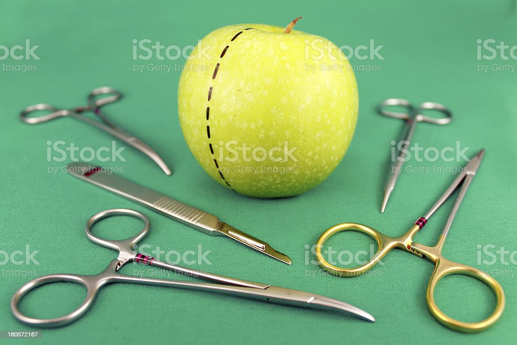 Surgical Equipments and Green Apple stock photo