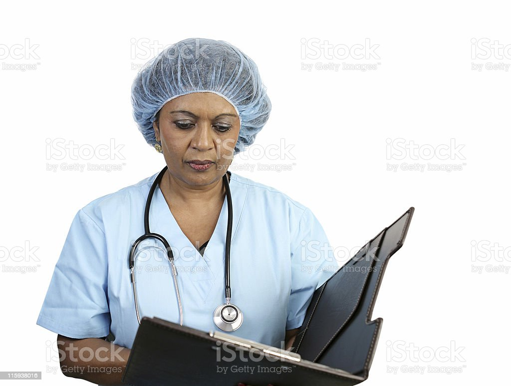 Surgical Nurse Reviews Chart royalty-free stock photo