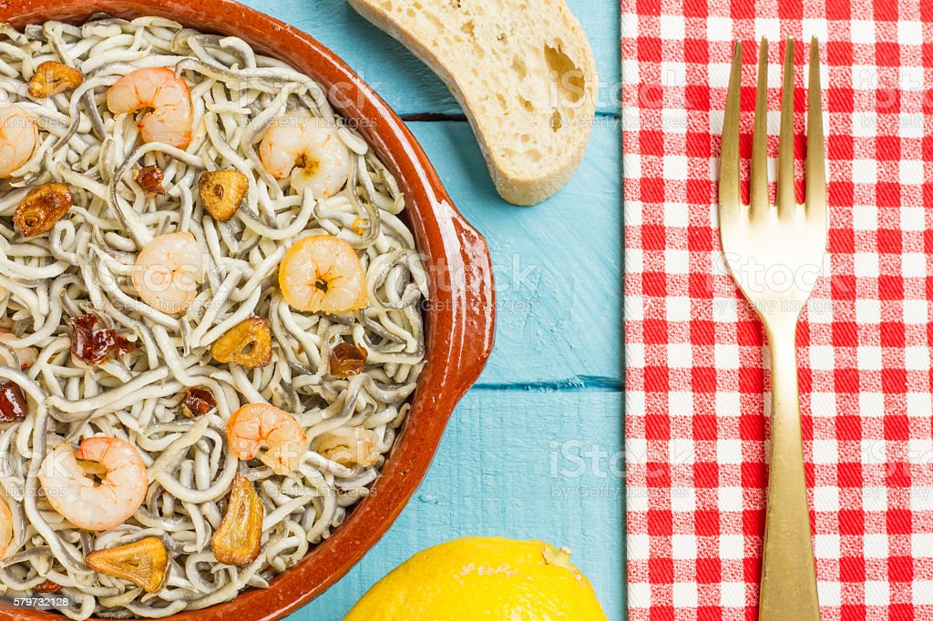 Surimi elvers with prawns, garlic and pepper stock photo