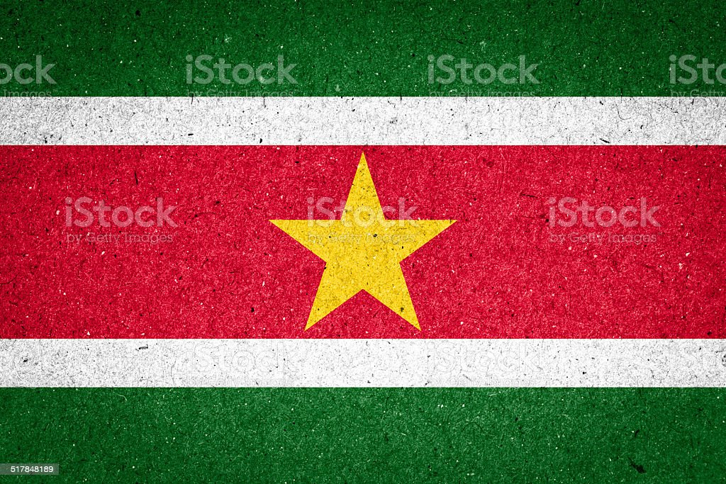 Suriname flag on paper background stock photo