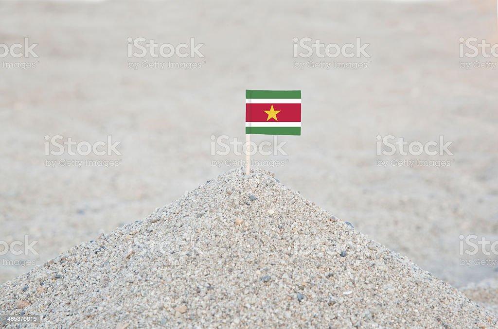 Suriname Flag on the Beach stock photo