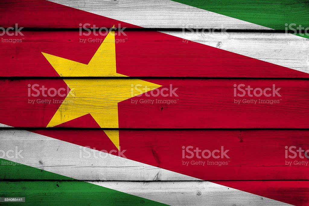 Suriname Flag on wood background stock photo
