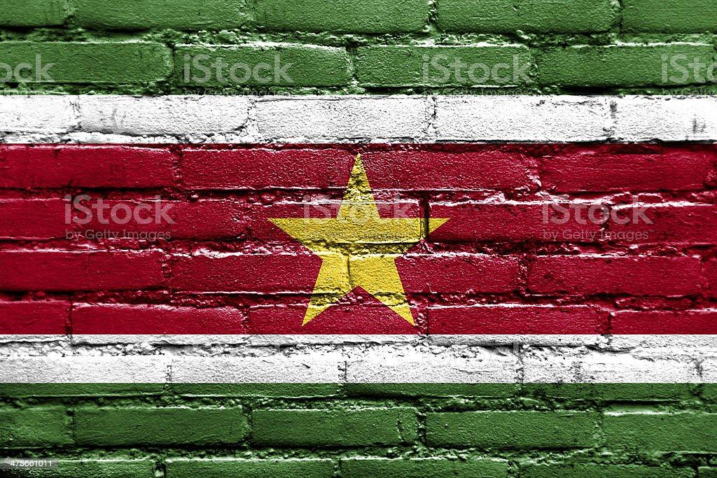 Suriname Flag painted on brick wall stock photo