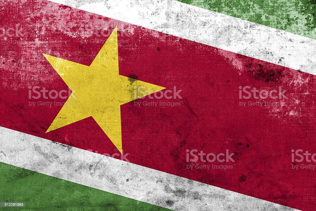 Suriname Flag with a vintage and old look stock photo