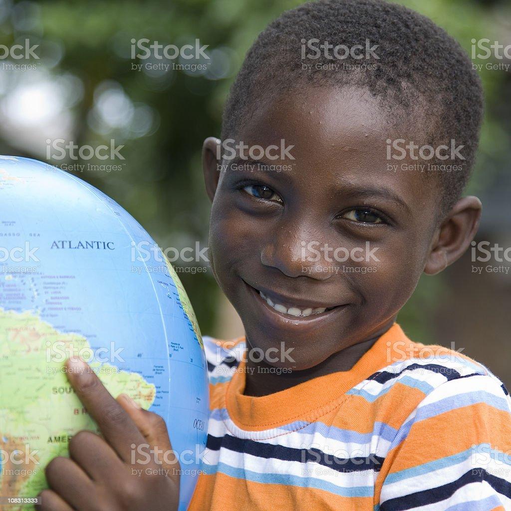 Suriname, pointing at a globe. stock photo