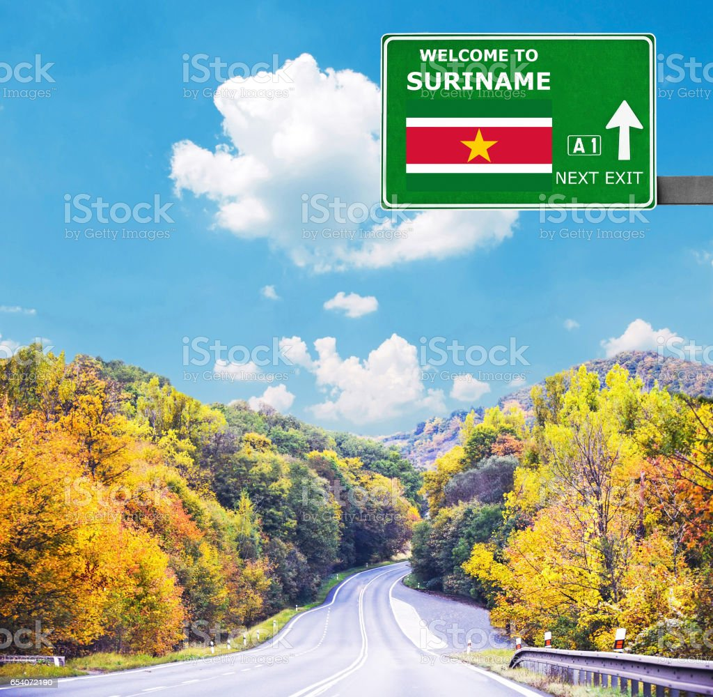 Suriname road sign against clear blue sky stock photo