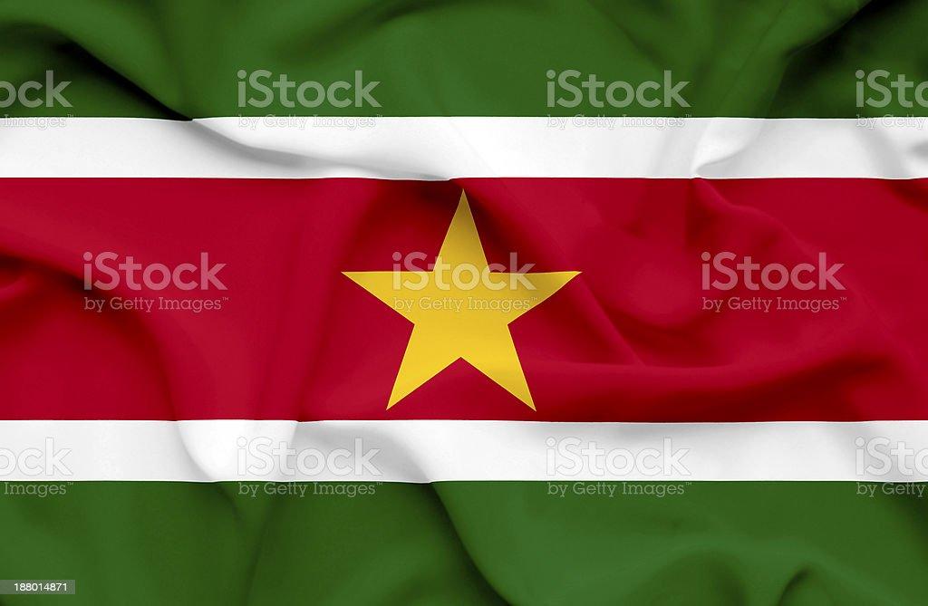 Suriname waving flag stock photo