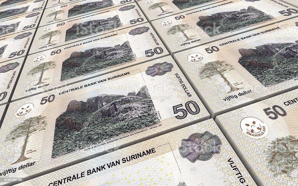 Surinamese dollar bills stacks background. stock photo