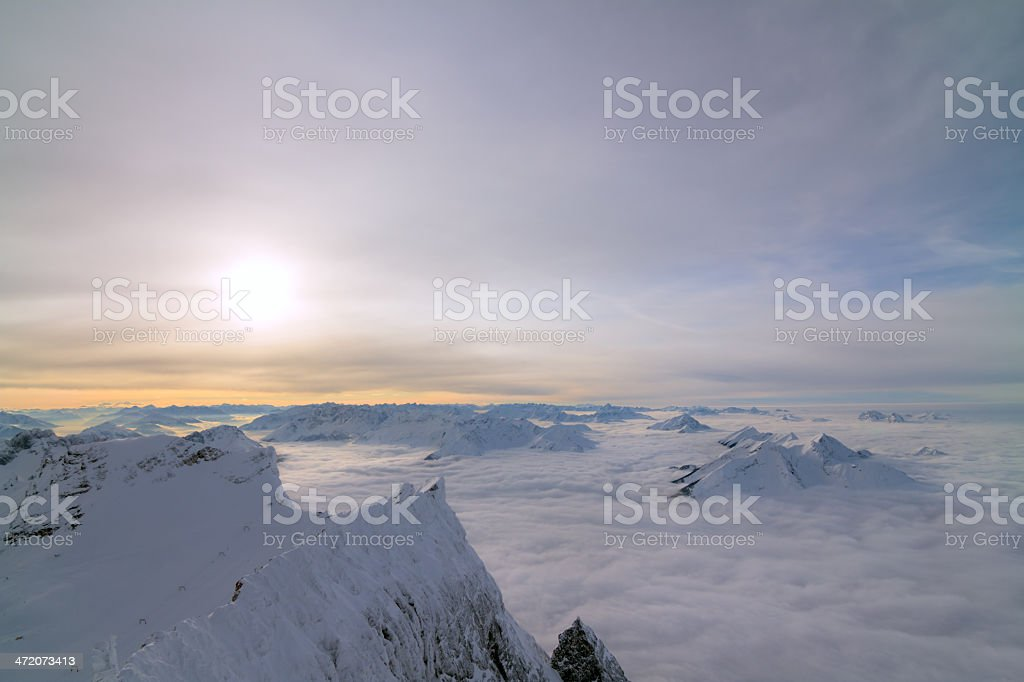 suropean sunset above the fog stock photo