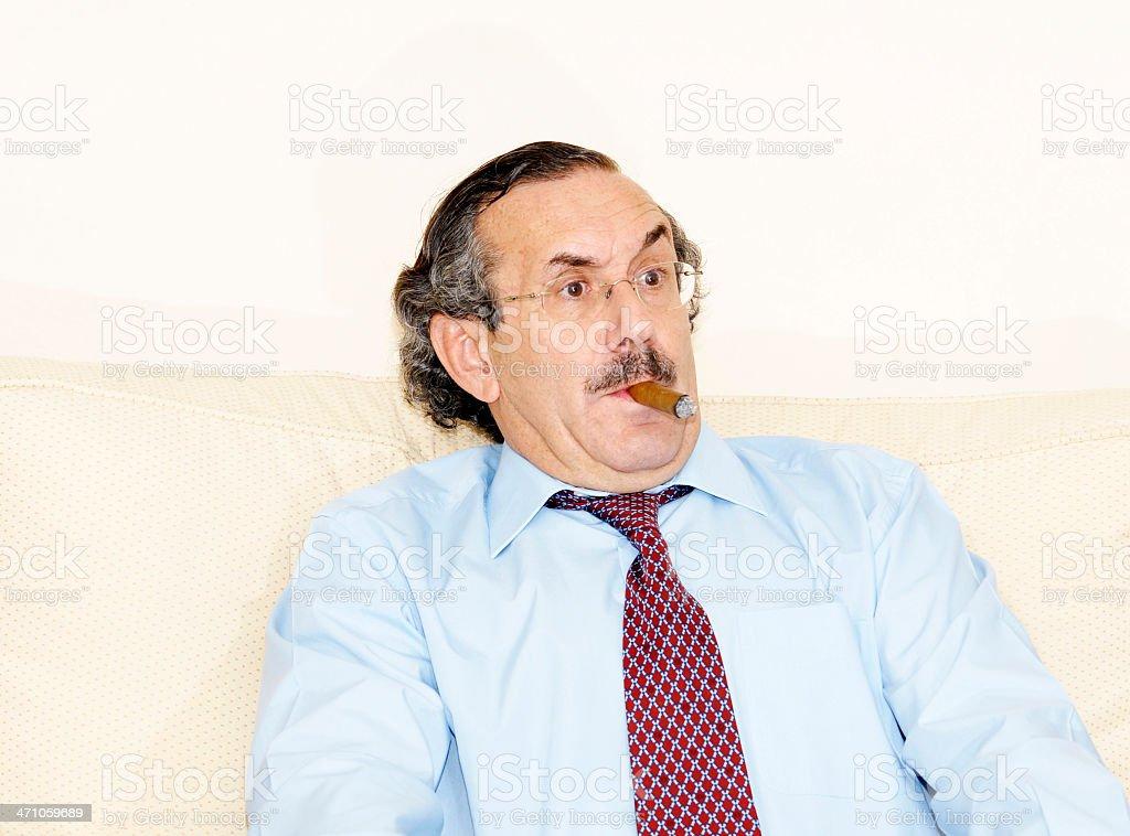 Surpised senior with cigar royalty-free stock photo