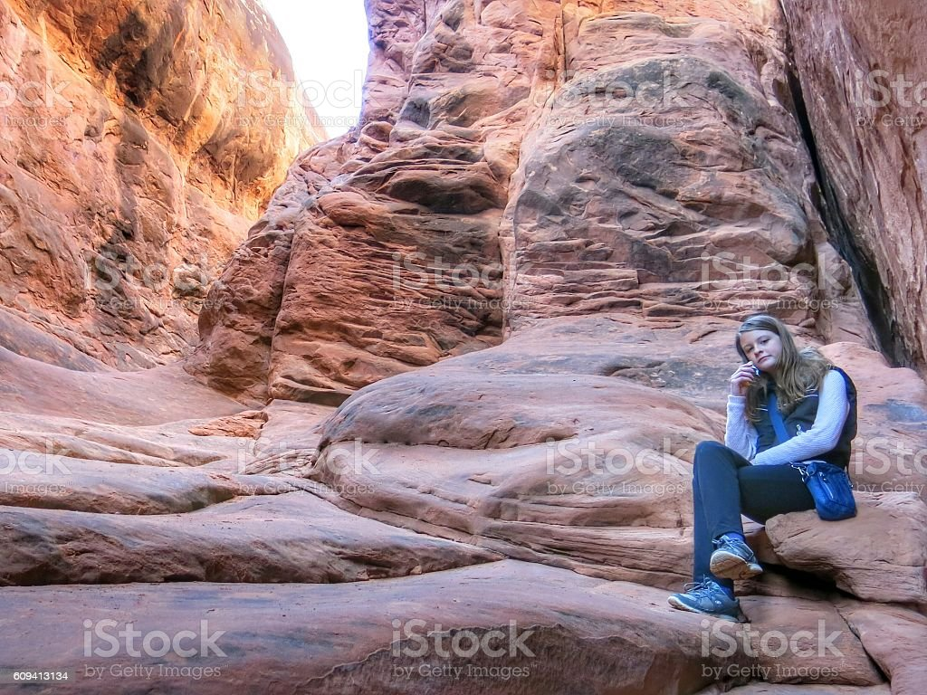 Surprise Arch, Fiery Furnace, Teenage Bored Girl, Arches National Park stock photo