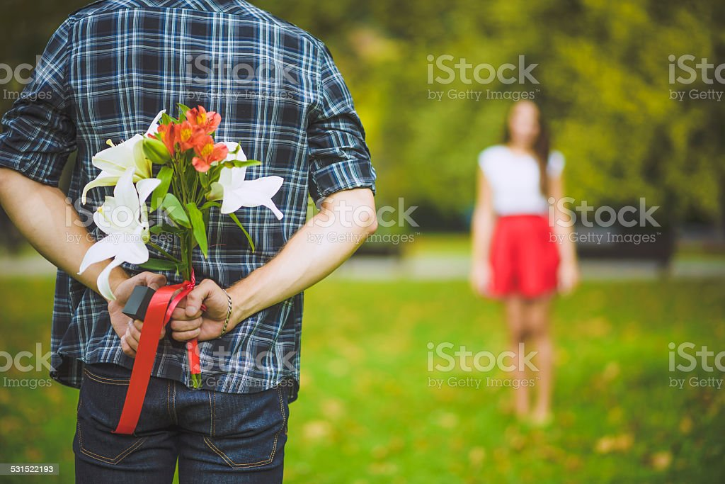 Surprise behind back stock photo