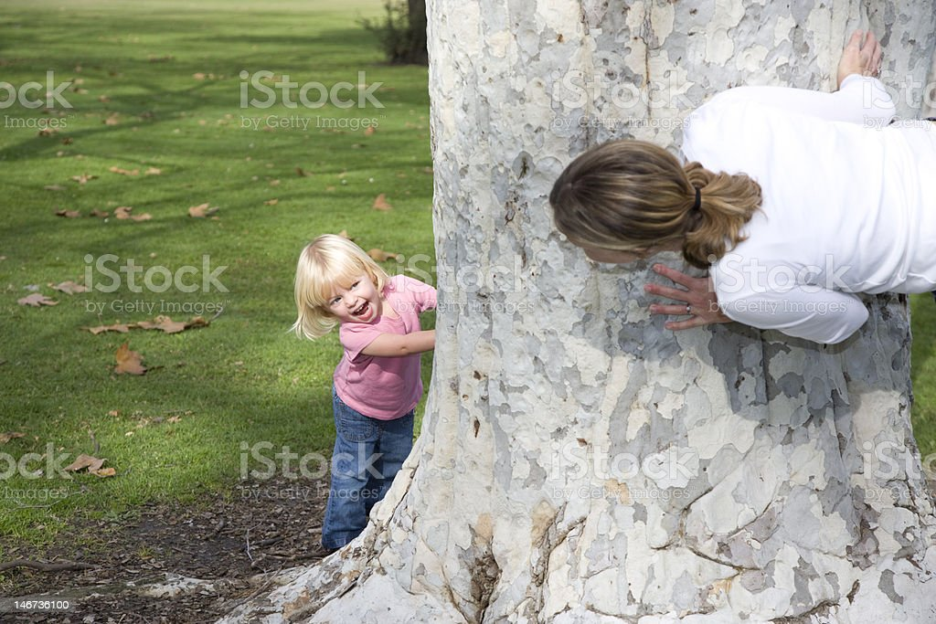 Surprise behind tree. stock photo