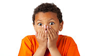 Surprised 8-year old mixed race boy on white
