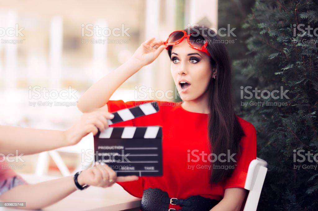 Surprised Actress with Oversized Sunglasses Shooting Movie Scene stock photo