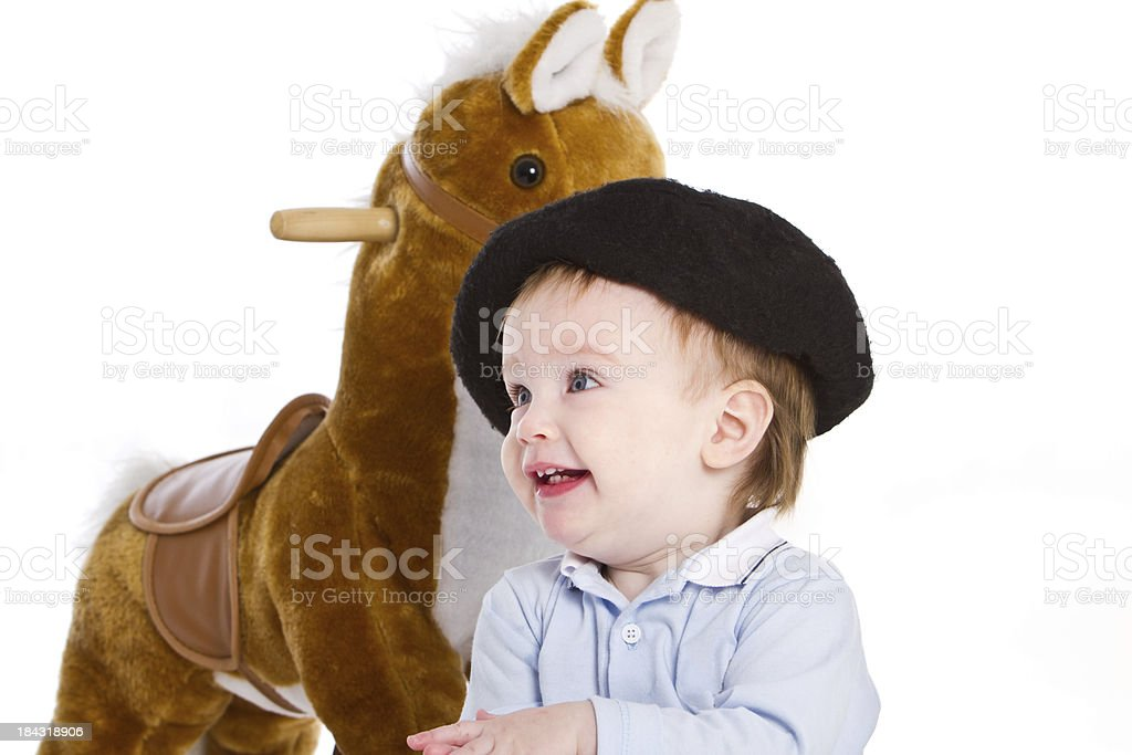 Surprised adorable baby as argentinean gaucho royalty-free stock photo