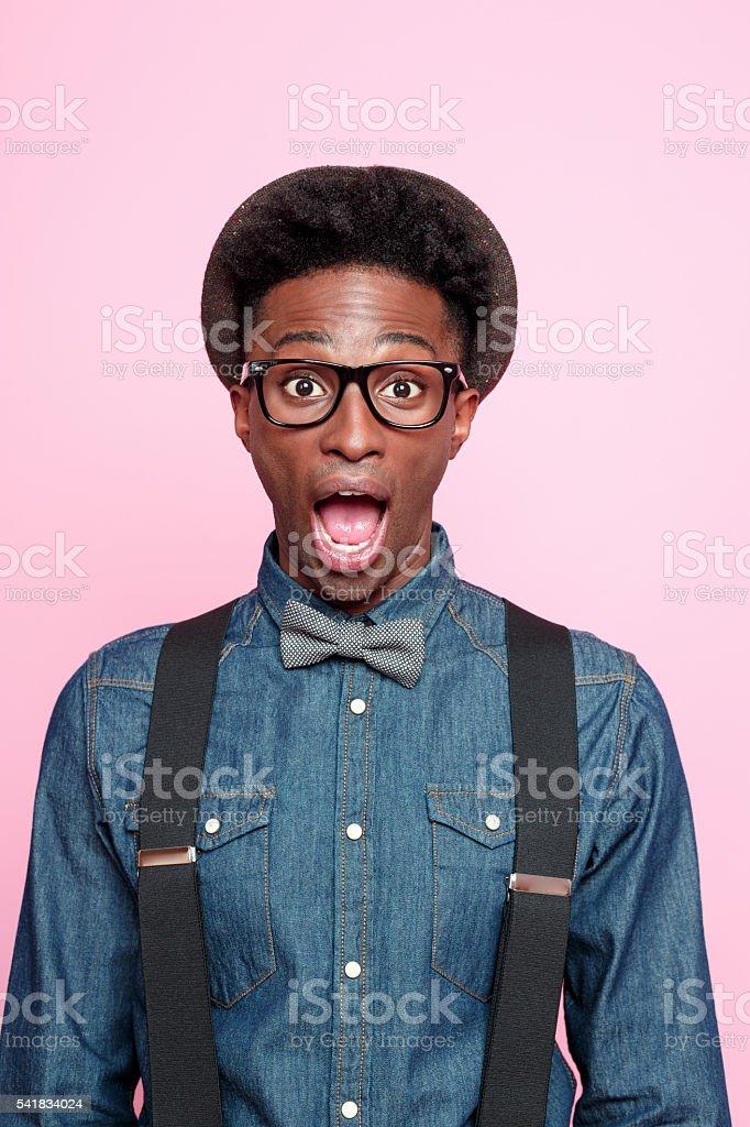 Surprised afro american nerd guy stock photo