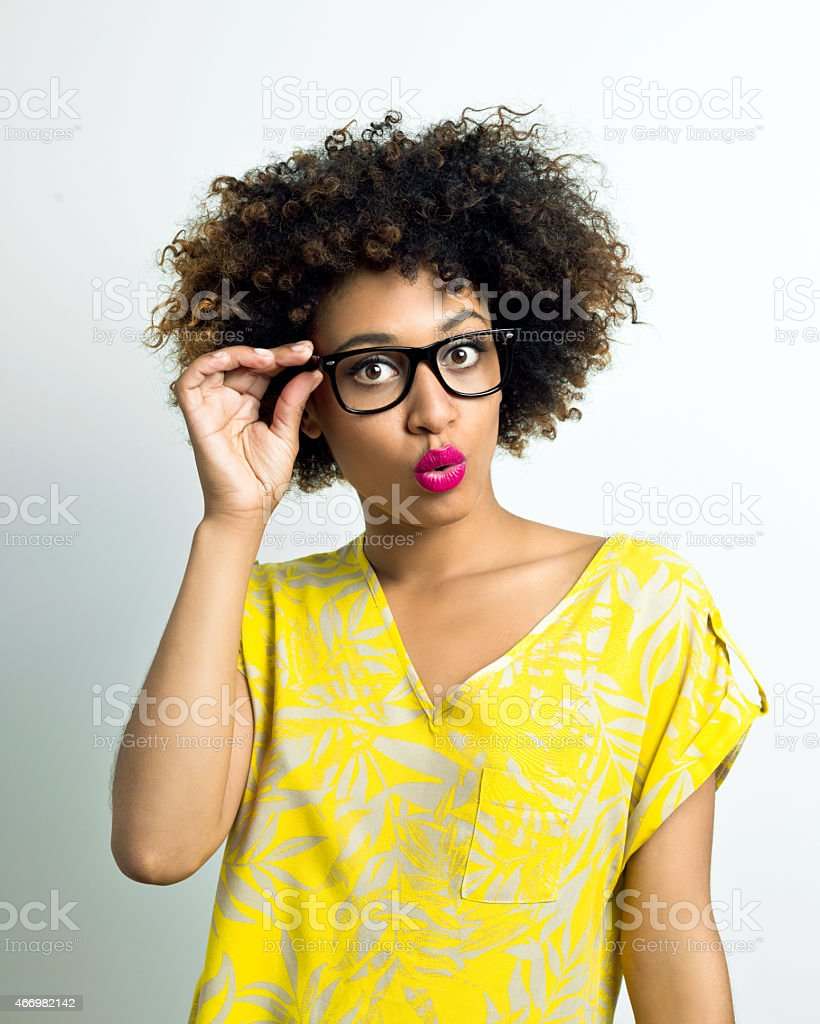 Surprised Afro Woman wearing glasses stock photo