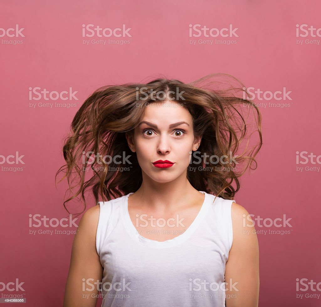 Surprised and confused woman stock photo
