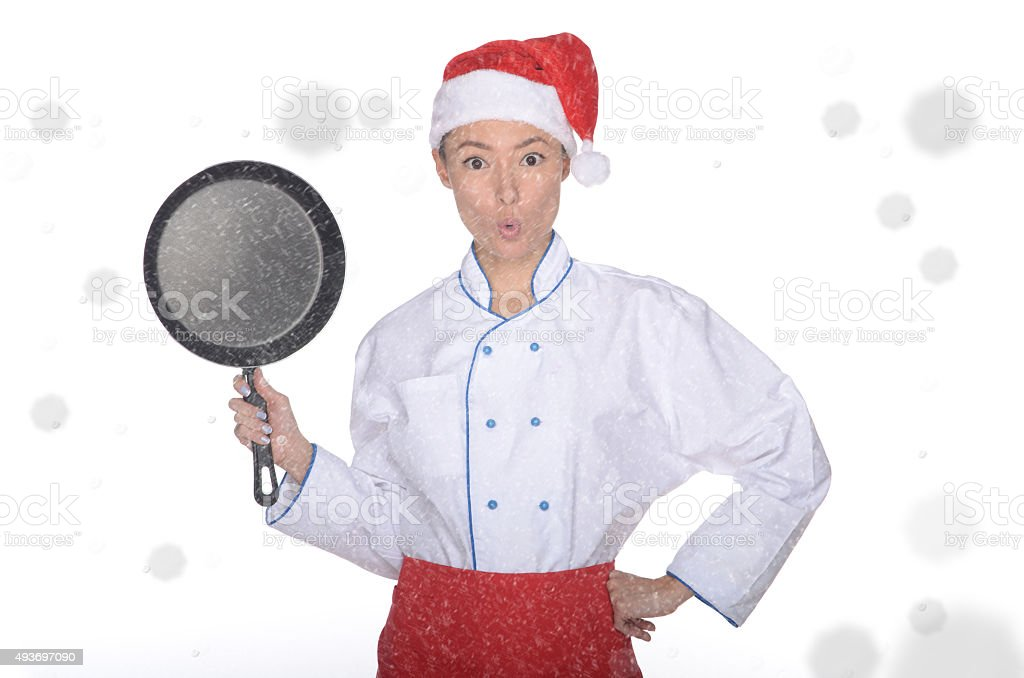 surprised asian chef with frying pan and Christmas hat stock photo