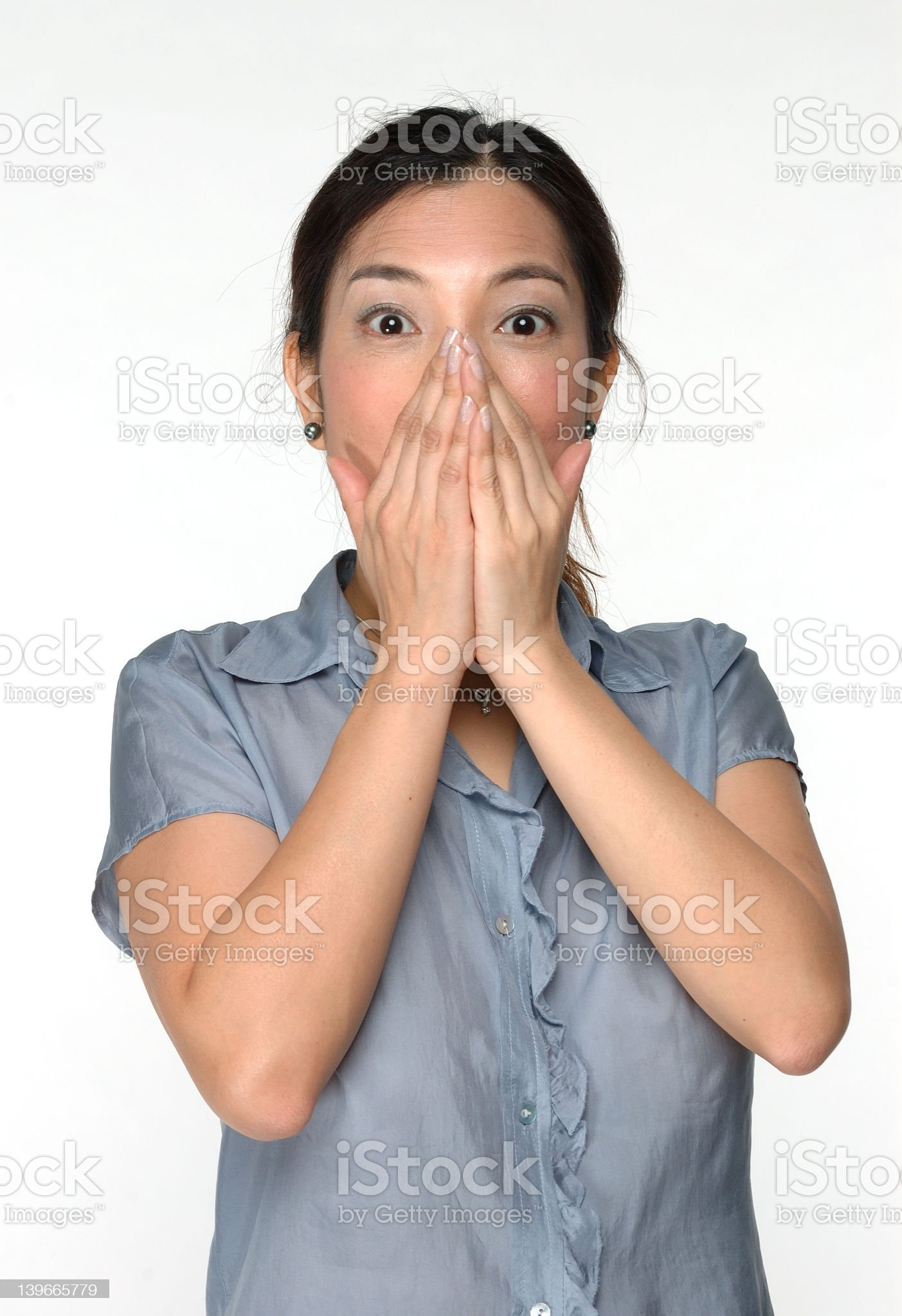 Surprised Asian woman on white background royalty-free stock photo