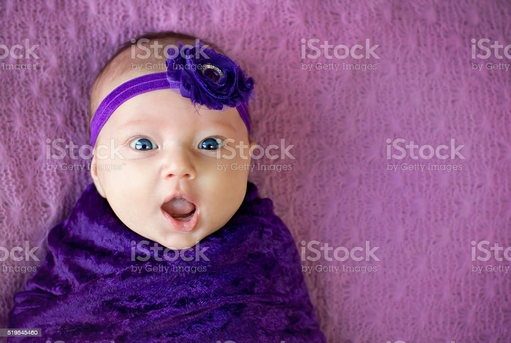 Surprised baby girl stock photo