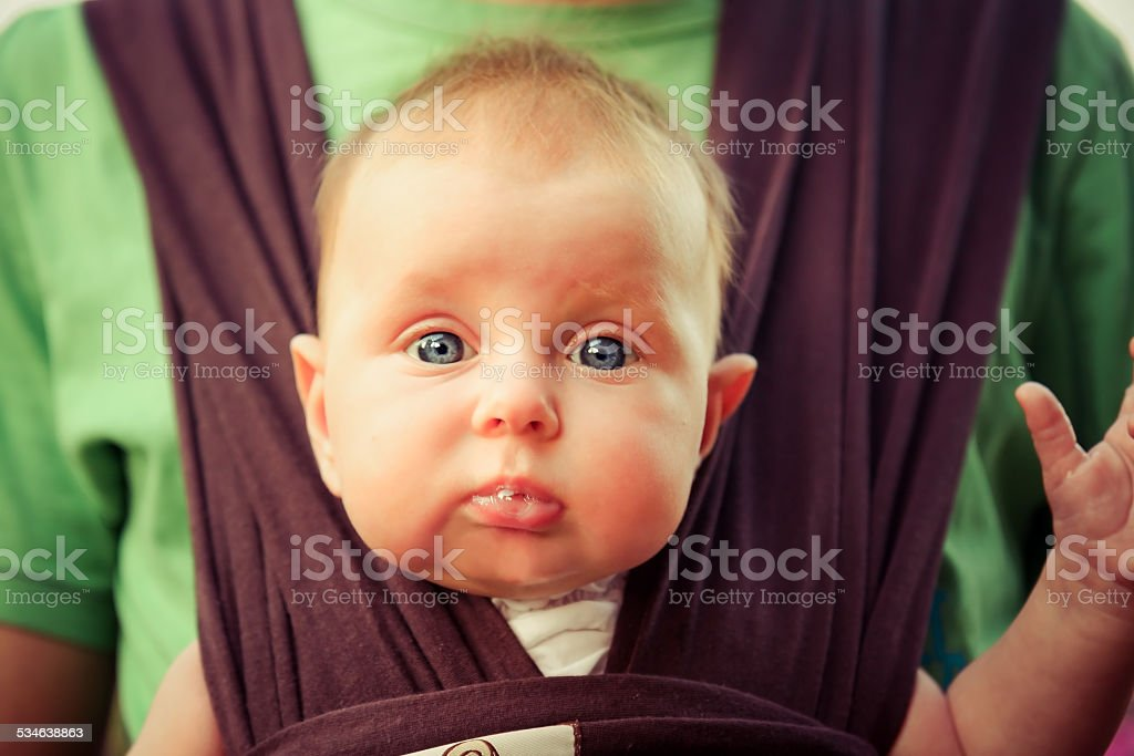 surprised baby looking on camera stock photo