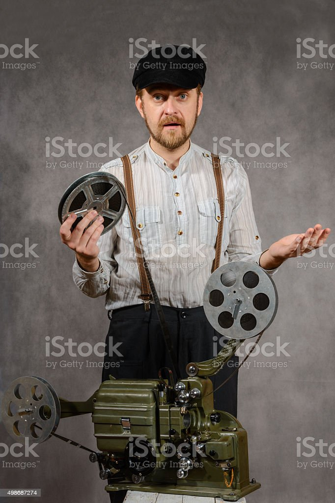 surprised  bearded projectionist stock photo