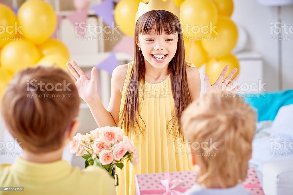 Surprised birthday girl stock photo