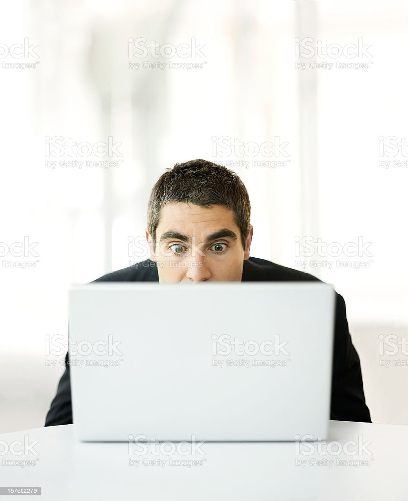 Surprised business man with computer stock photo