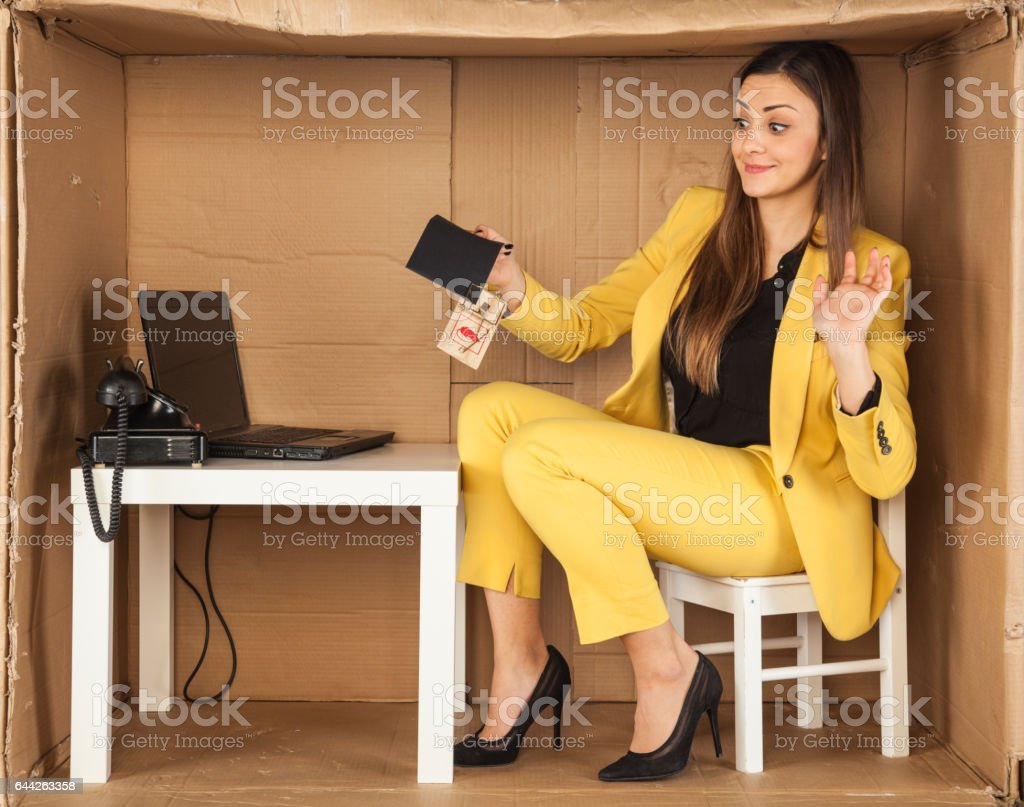 surprised business woman holds the trap of a bribe stock photo