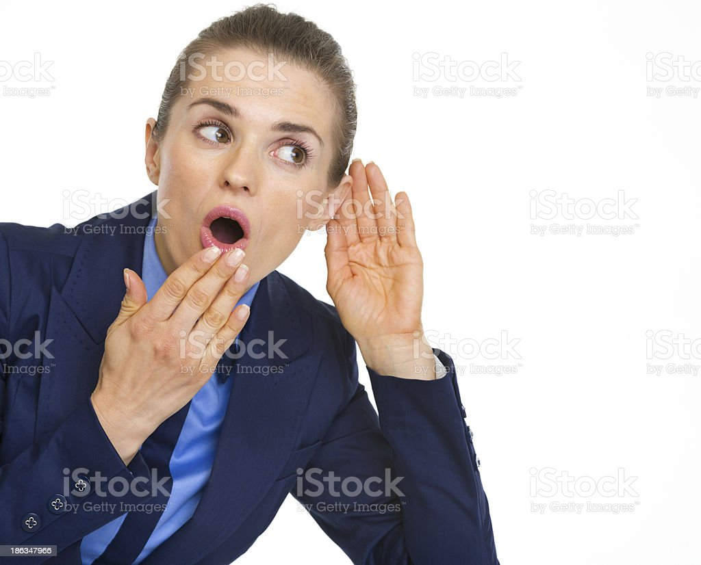 Surprised business woman listening royalty-free stock photo