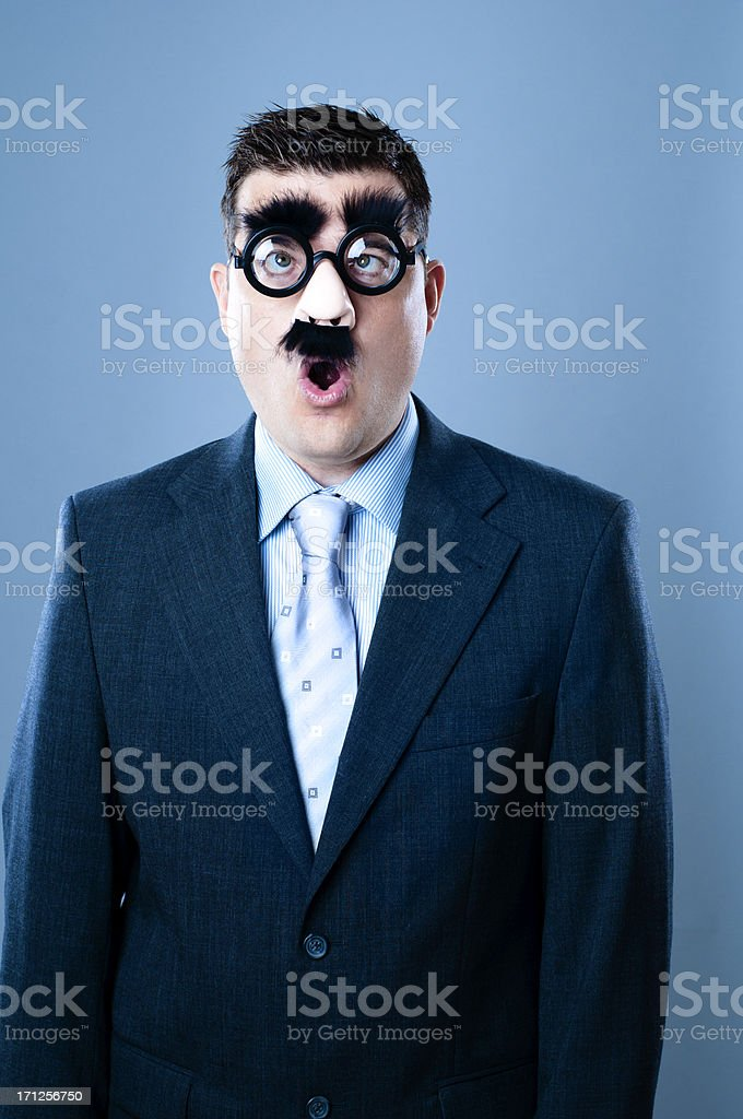 Surprised businessman in disguise royalty-free stock photo