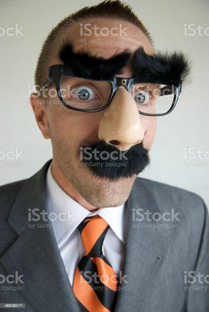 Surprised Businessman in Groucho Marx Disguise stock photo