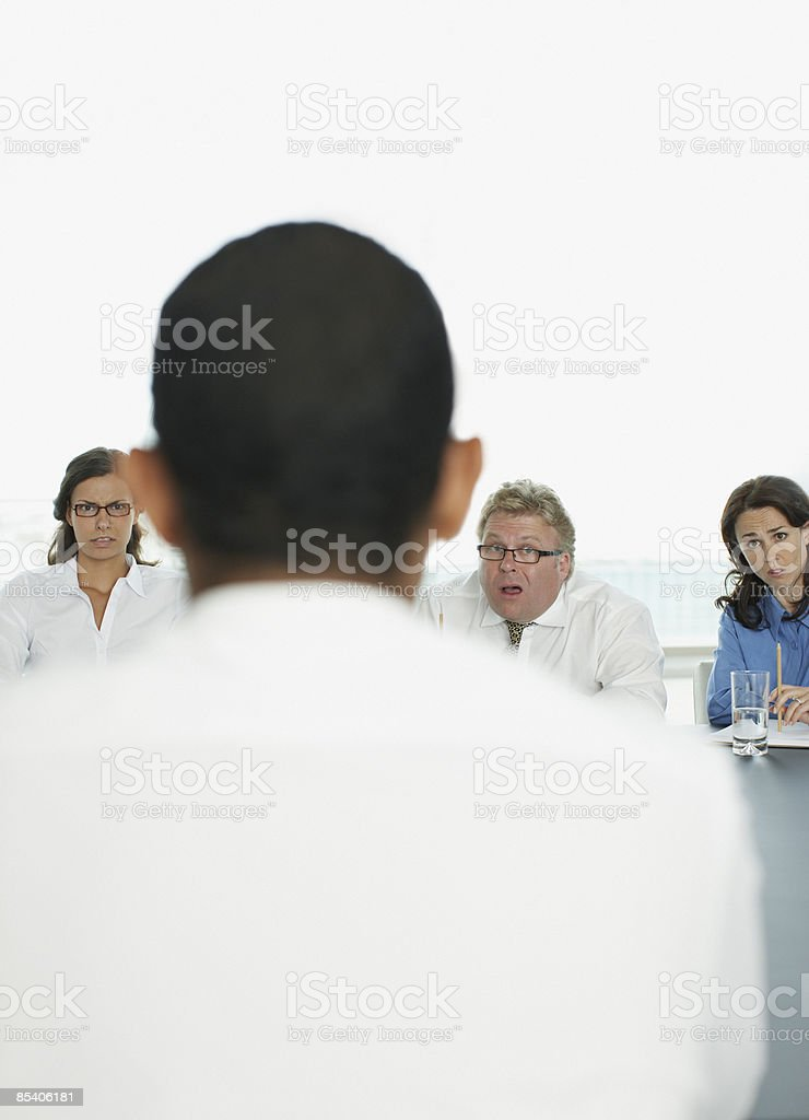 Surprised businessman in interview in conference room royalty-free stock photo